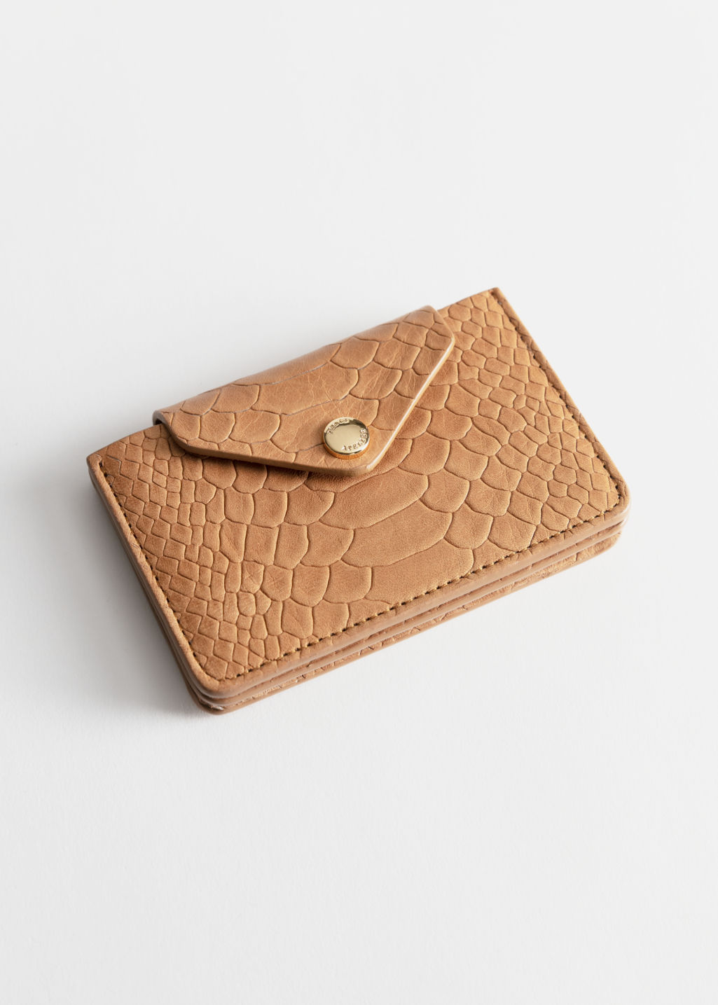 Front image of Stories leather card holder in beige