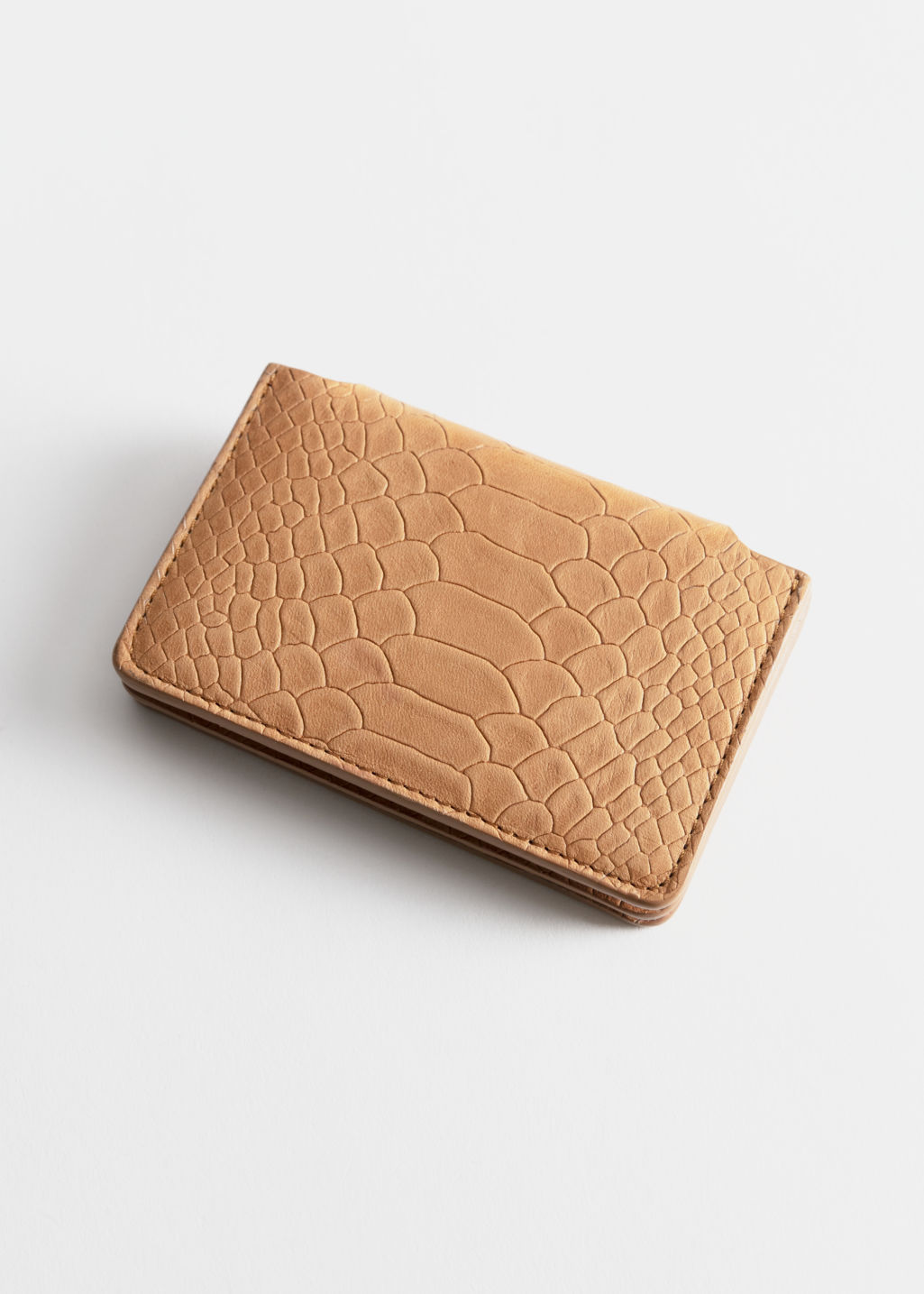 Back image of Stories leather card holder in beige