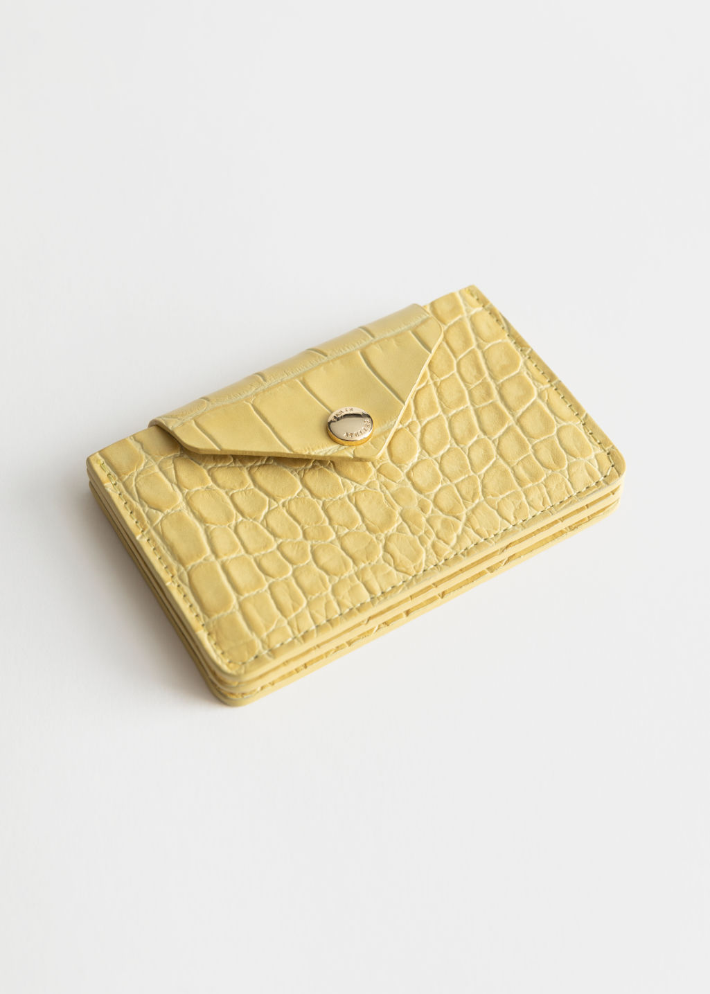 Front image of Stories leather card holder in yellow