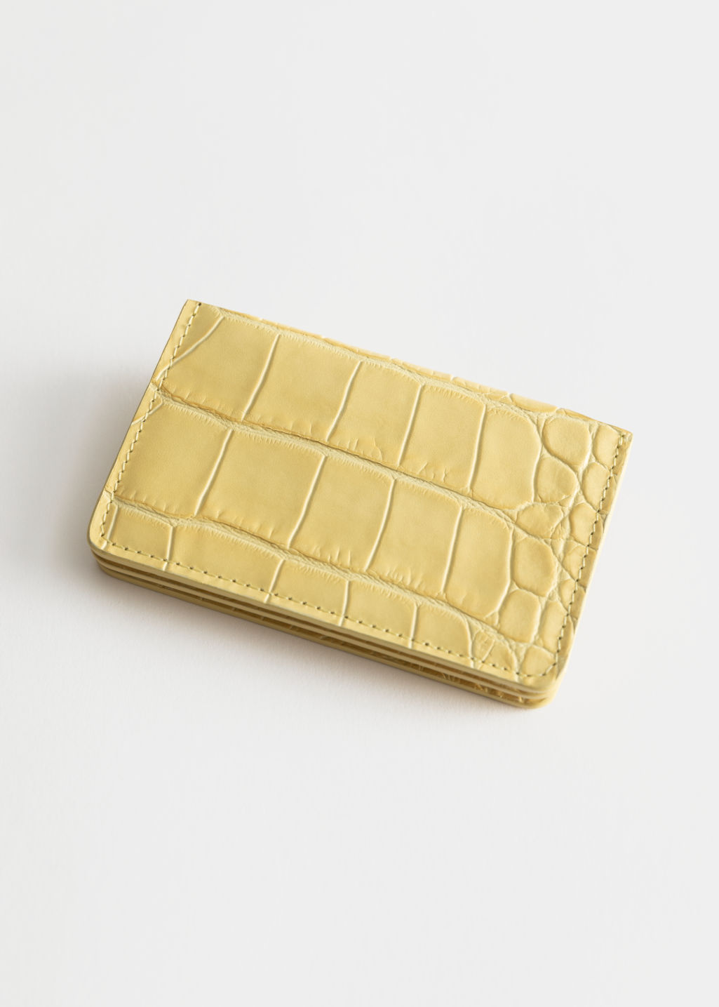 Back image of Stories leather card holder in yellow