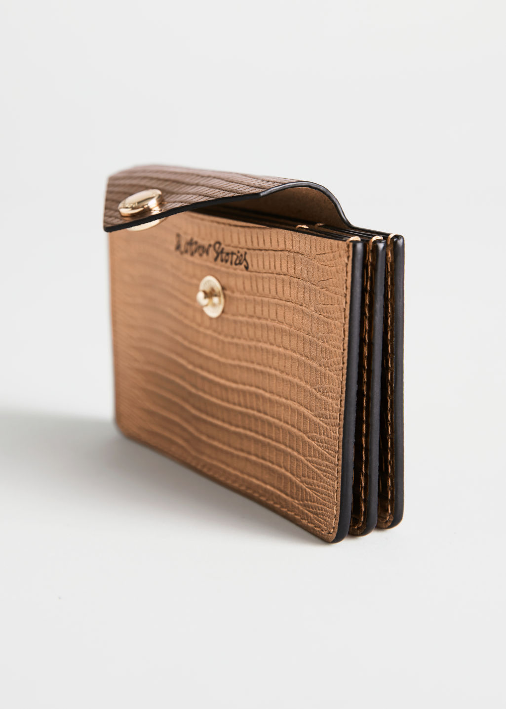 Side image of Stories leather card holder in brown