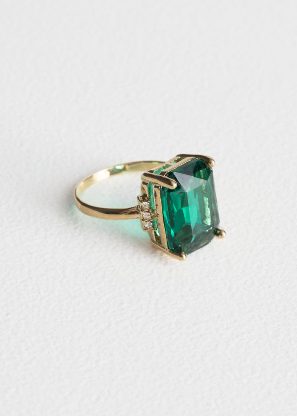 Front image of Stories emerald ring in green