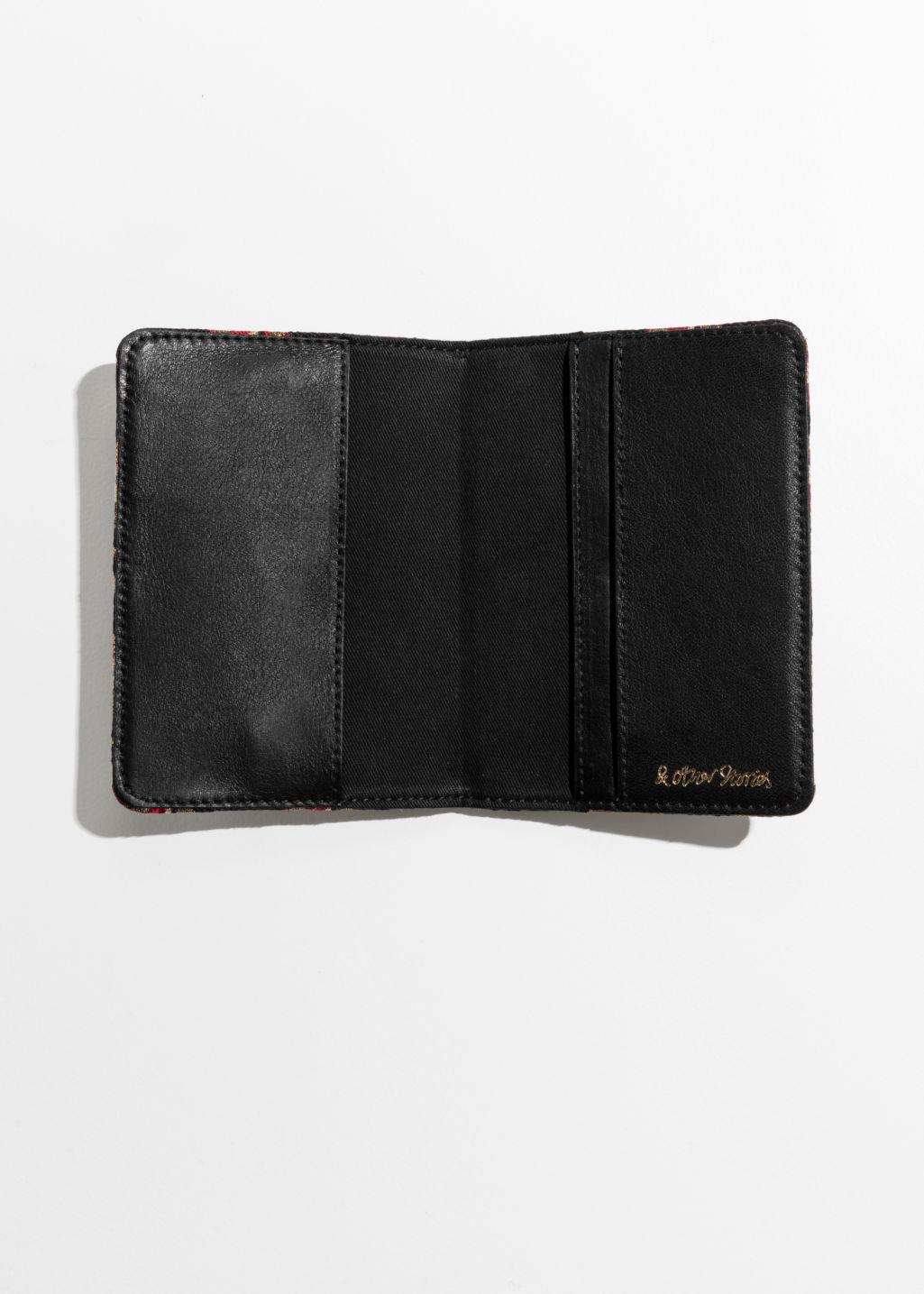 Back image of Stories leather passport holder in blue
