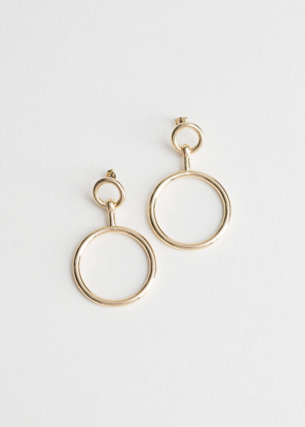 Front image of Stories ring earrings in gold
