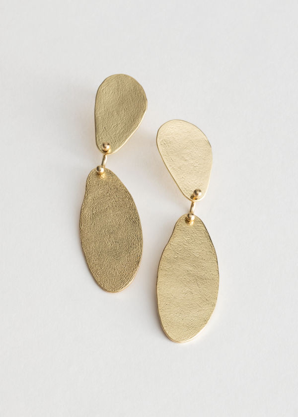 Front image of Stories textured two piece earrings in gold