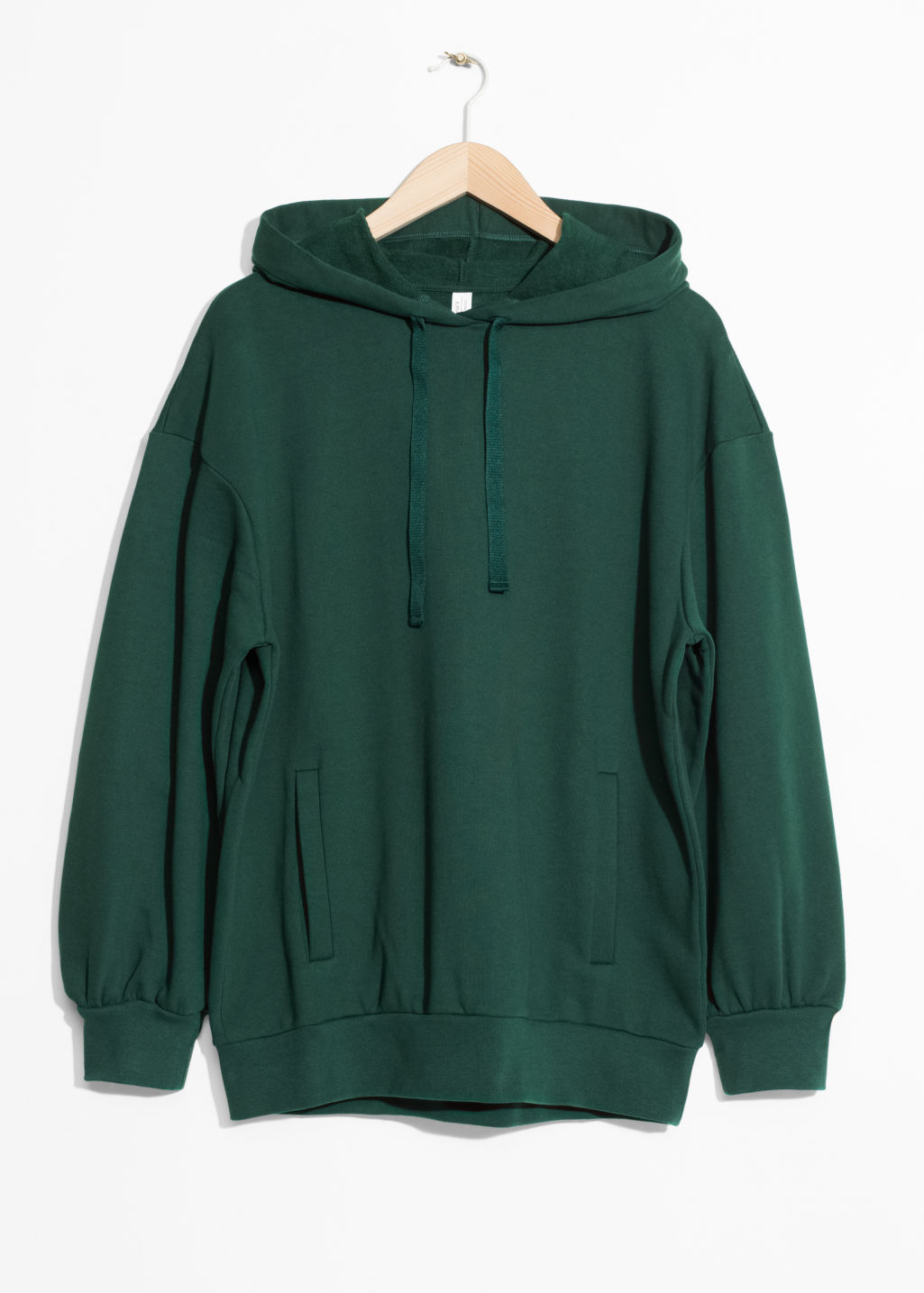 Front image of Stories oversized sweatshirt in green