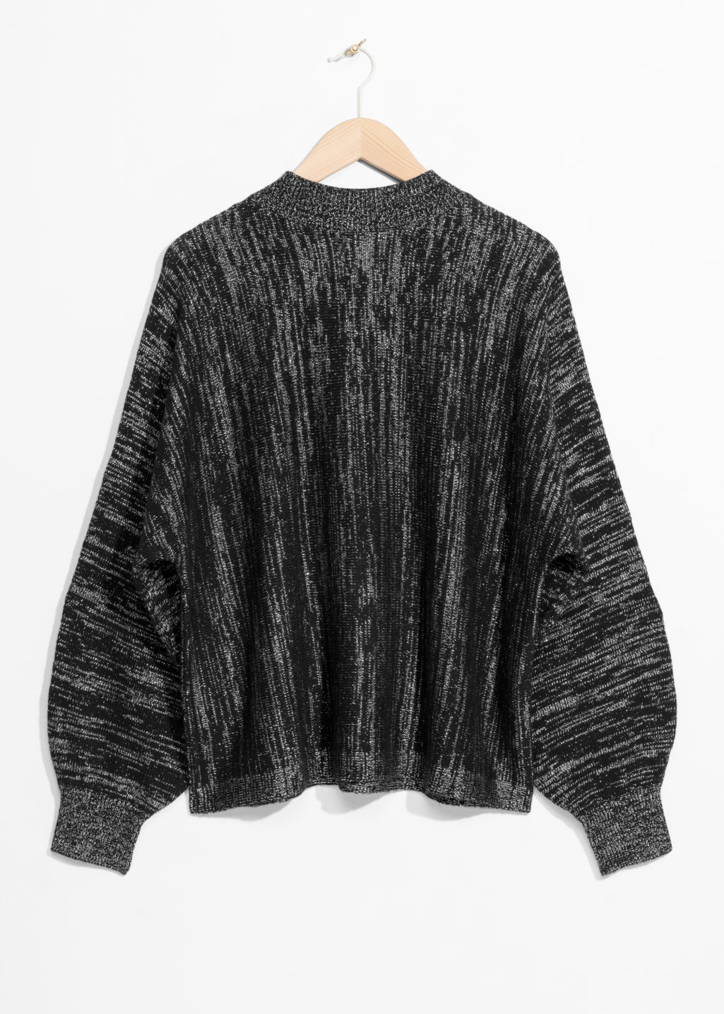 Front image of Stories metallic melange sweater in black