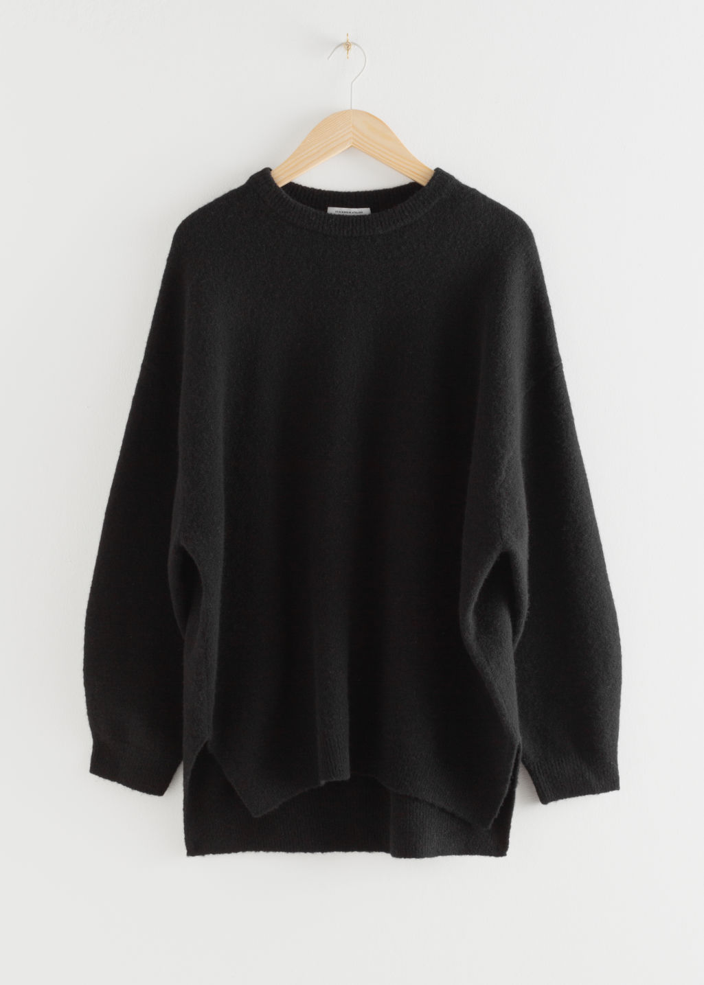 Front image of Stories wool sweater in black