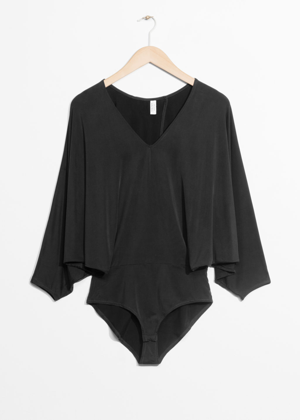 Front image of Stories batwing cupro body in black