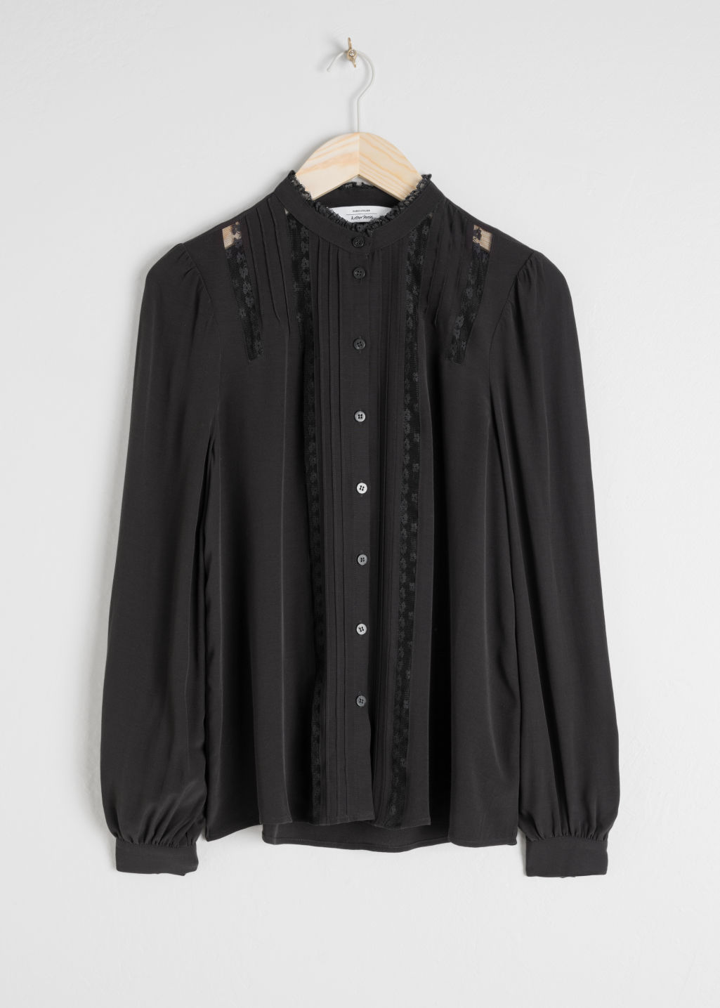 Front image of Stories lace panel blouse in black