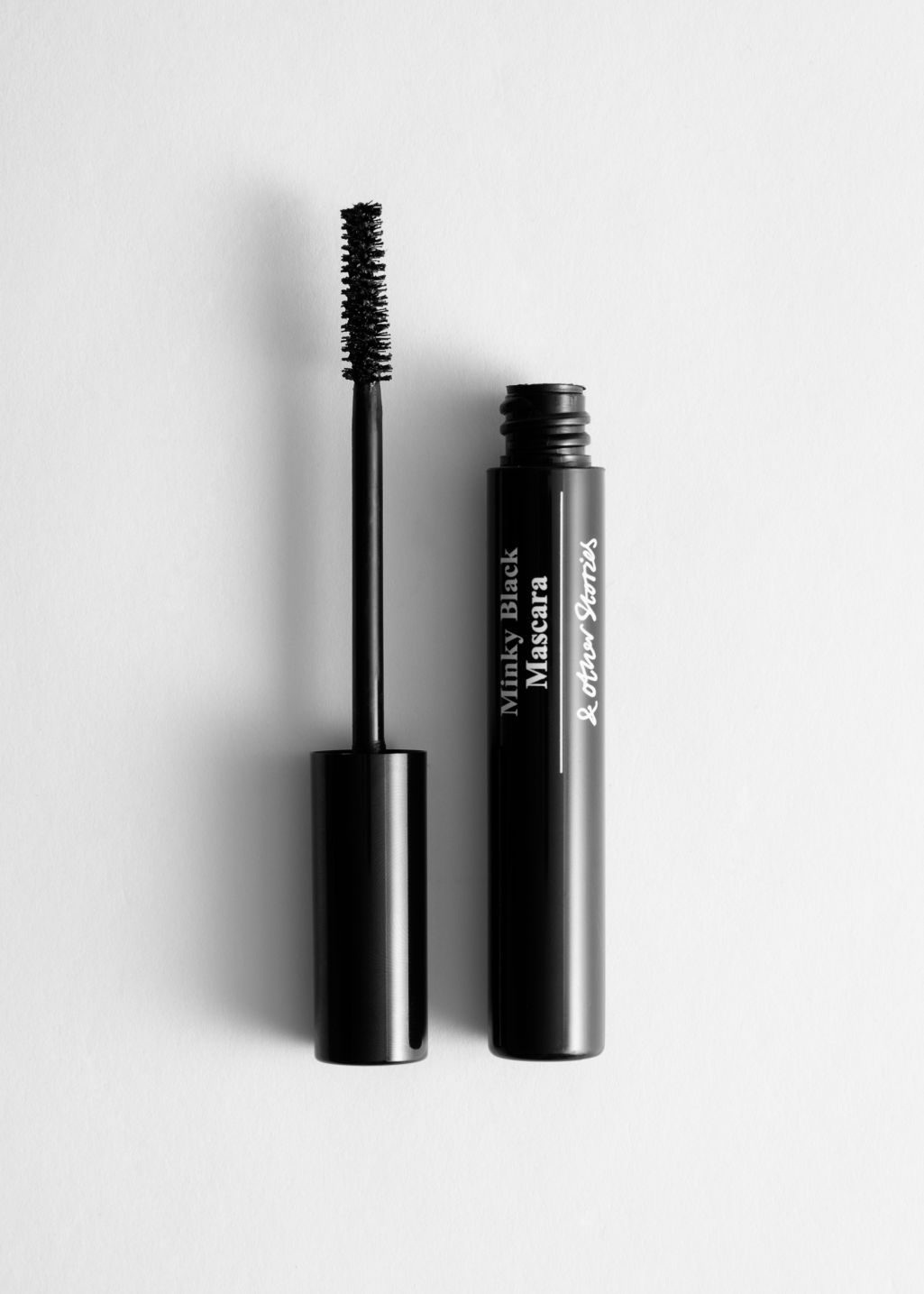 Front image of Stories dramatic volume mascara  in black