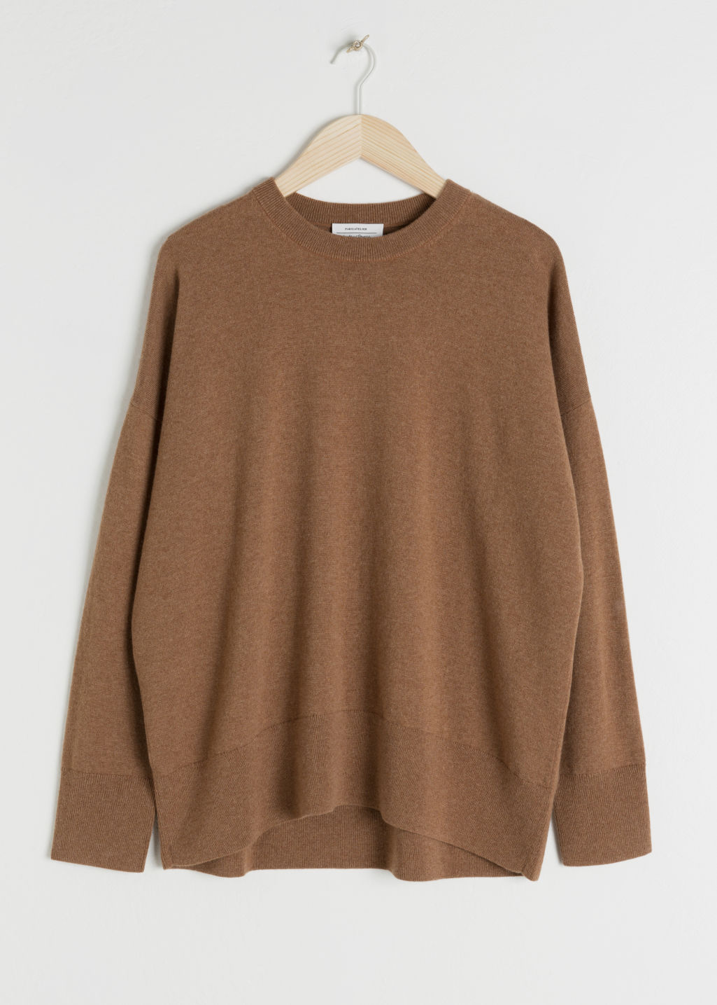 Front image of Stories cashmere sweater in beige
