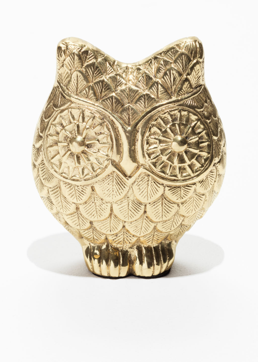 Front image of Stories owl paperweight in gold