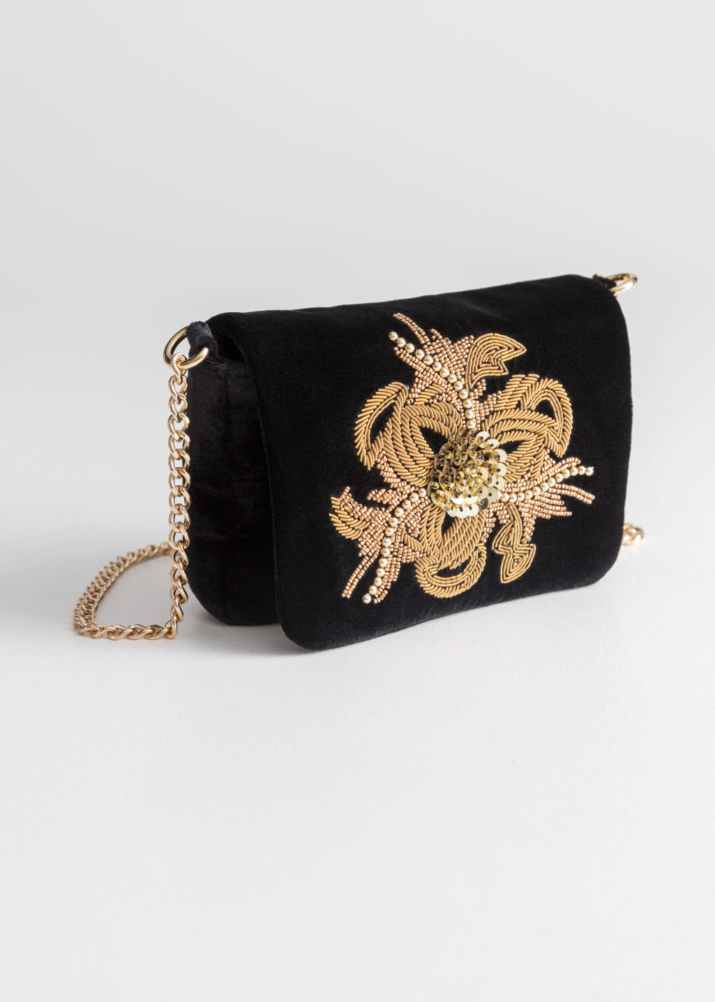 Front image of Stories beaded velvet crossbody bag in black