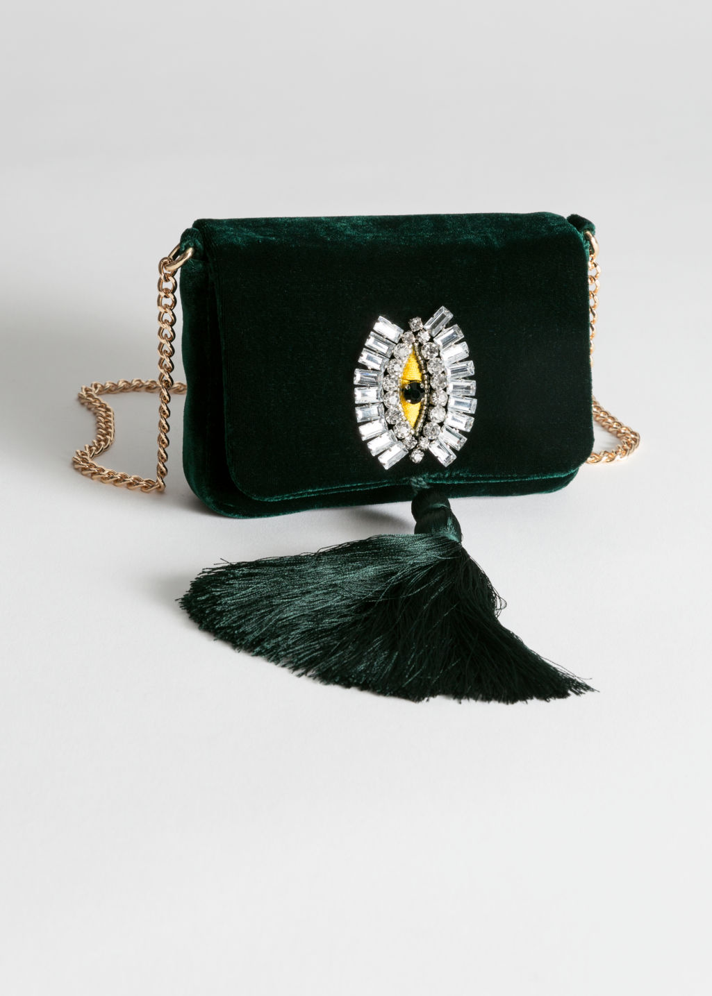 Front image of Stories beaded velvet crossbody bag in green
