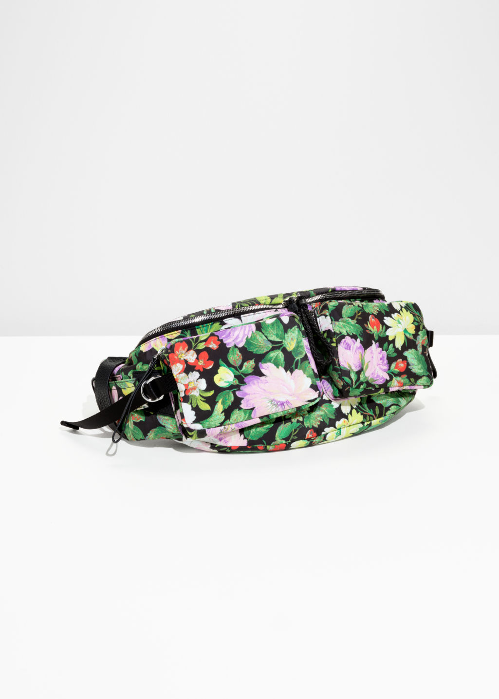 Front image of Stories floral hip sling bag in green