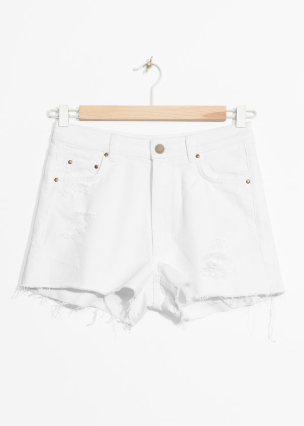 Front image of Stories shredded denim shorts in white