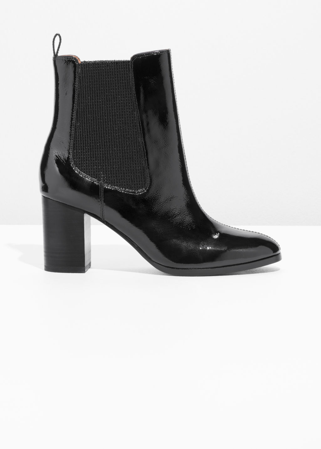 Front image of Stories patent leather chelsea boot  in black