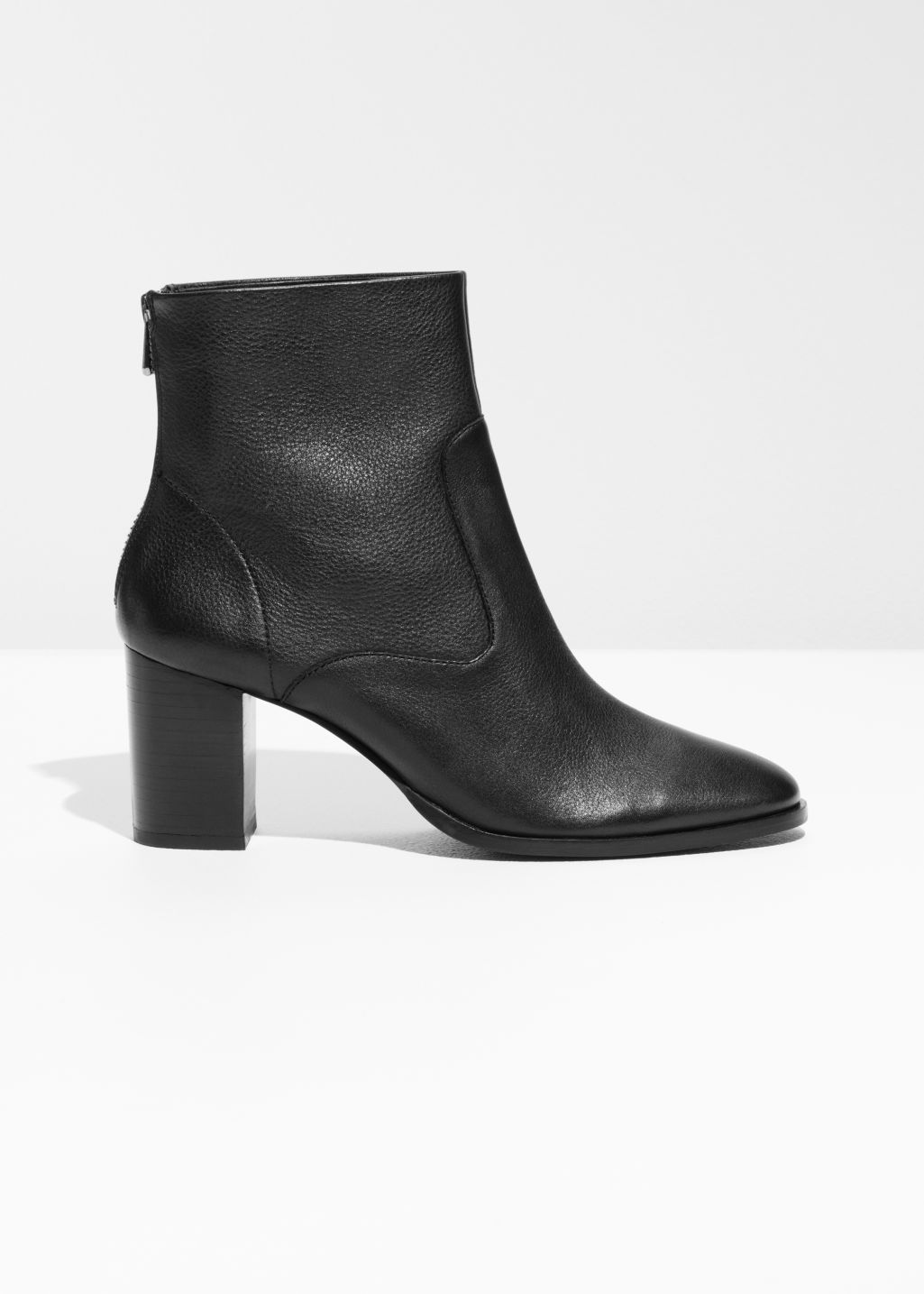 Front image of Stories heeled ankle boots in black
