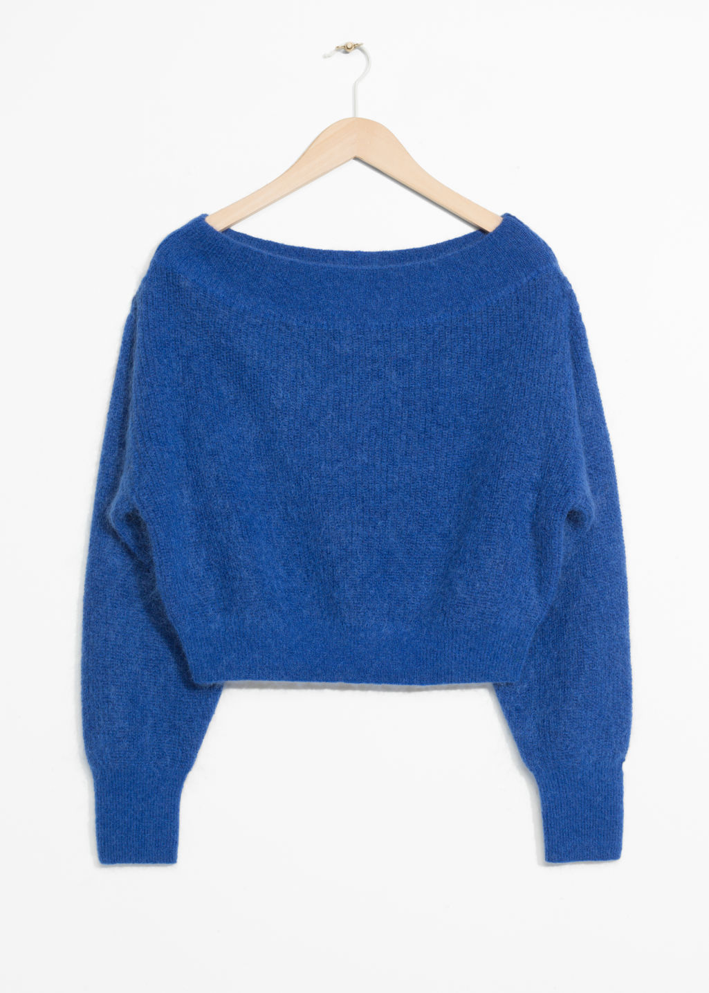 Front image of Stories knit off-shoulder sweater in blue