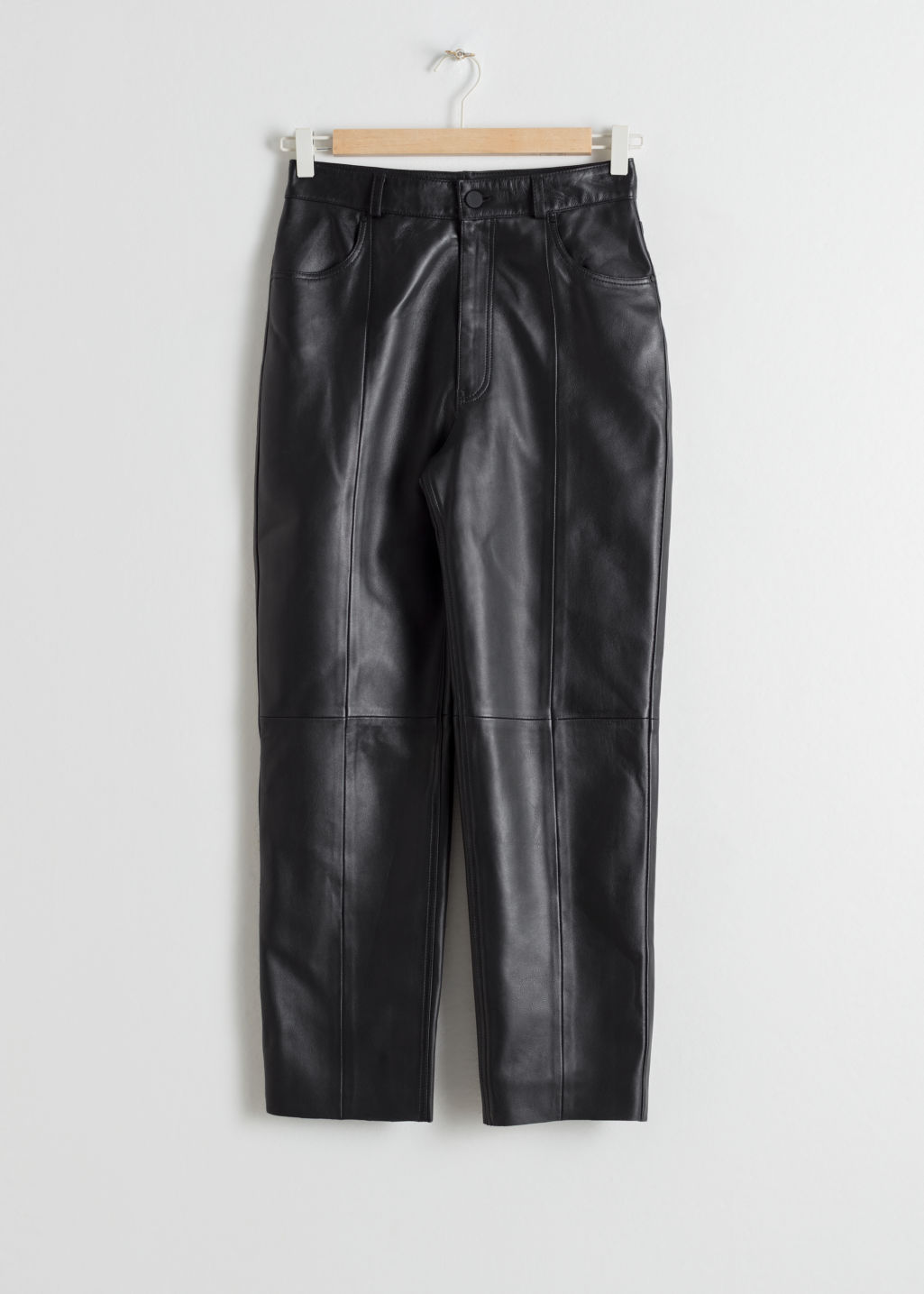 Front image of Stories leather trousers in black