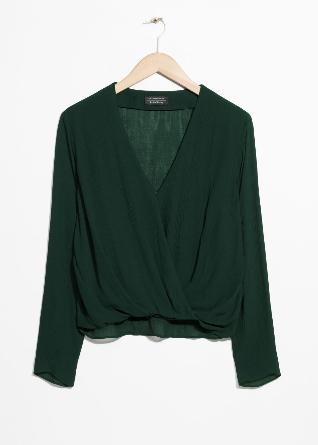 Front image of Stories wrap-effect blouse in green