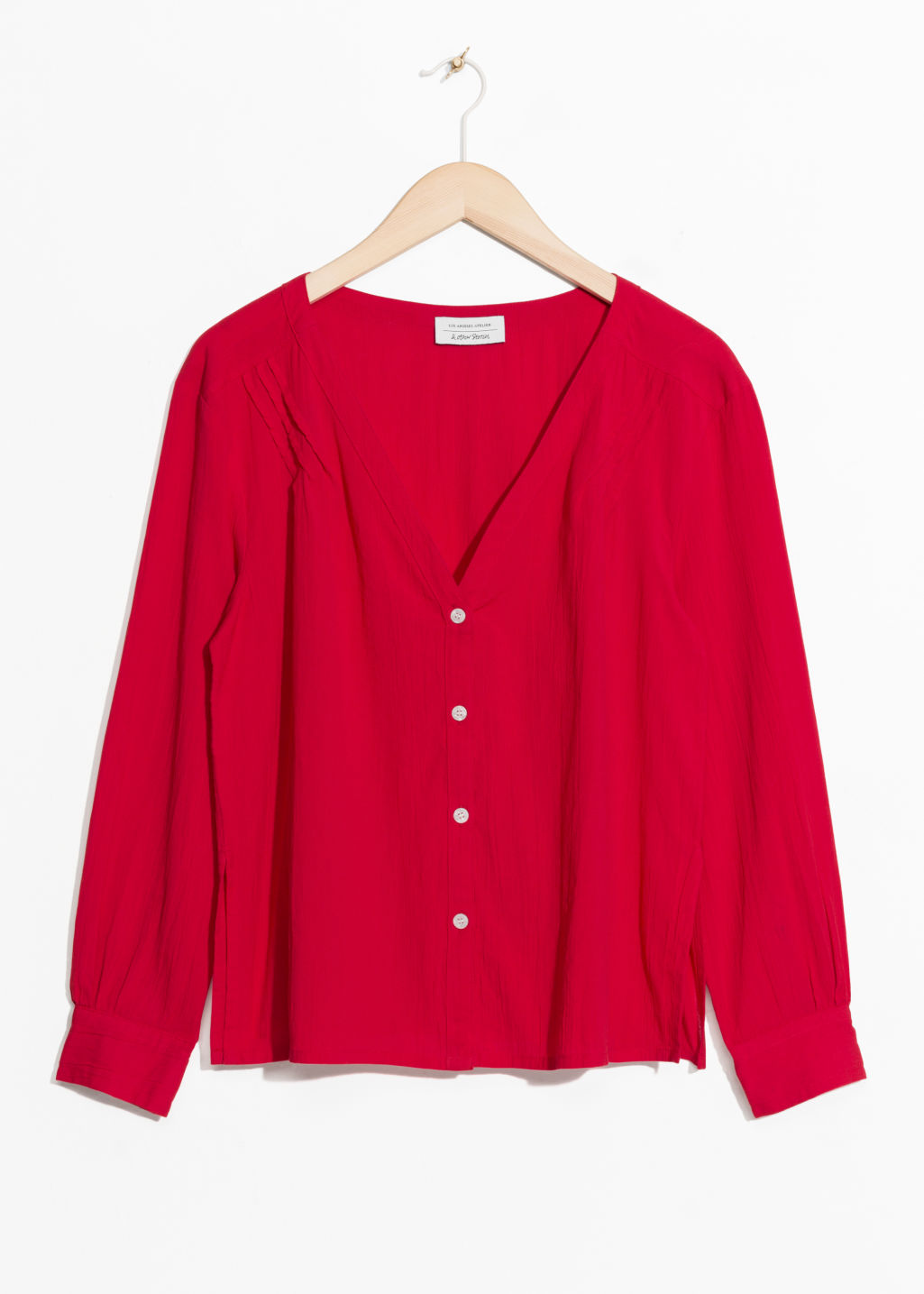 Front image of Stories v-neck blouse in red