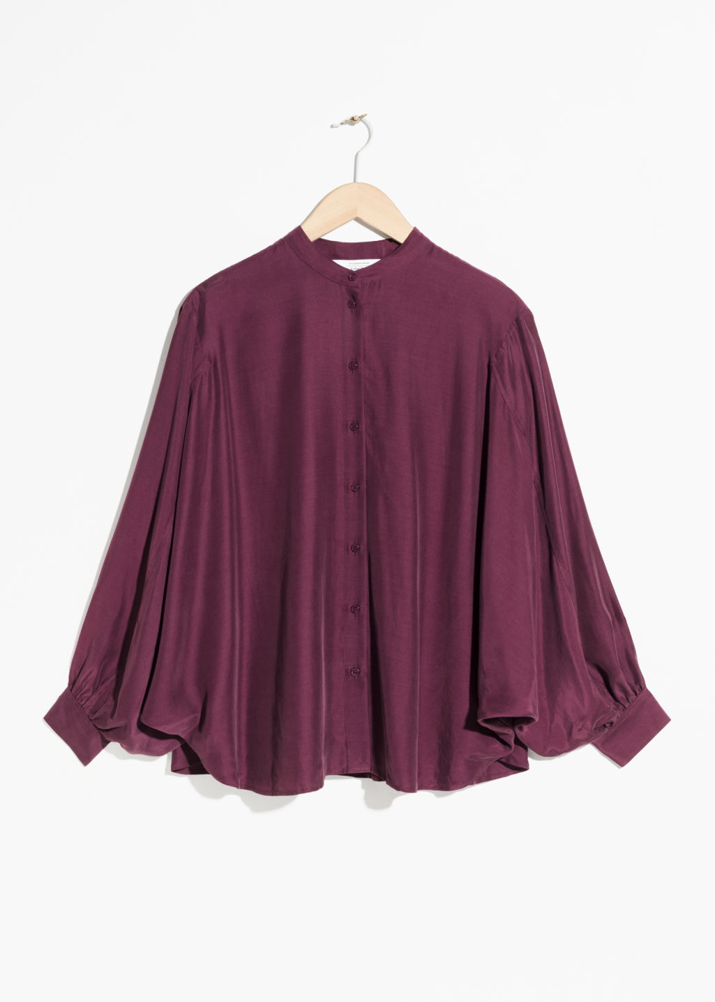 Front image of Stories batwing sleeve blouse in pink