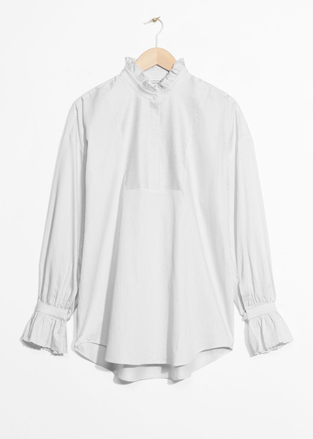 Front image of Stories scallop edge blouse in white