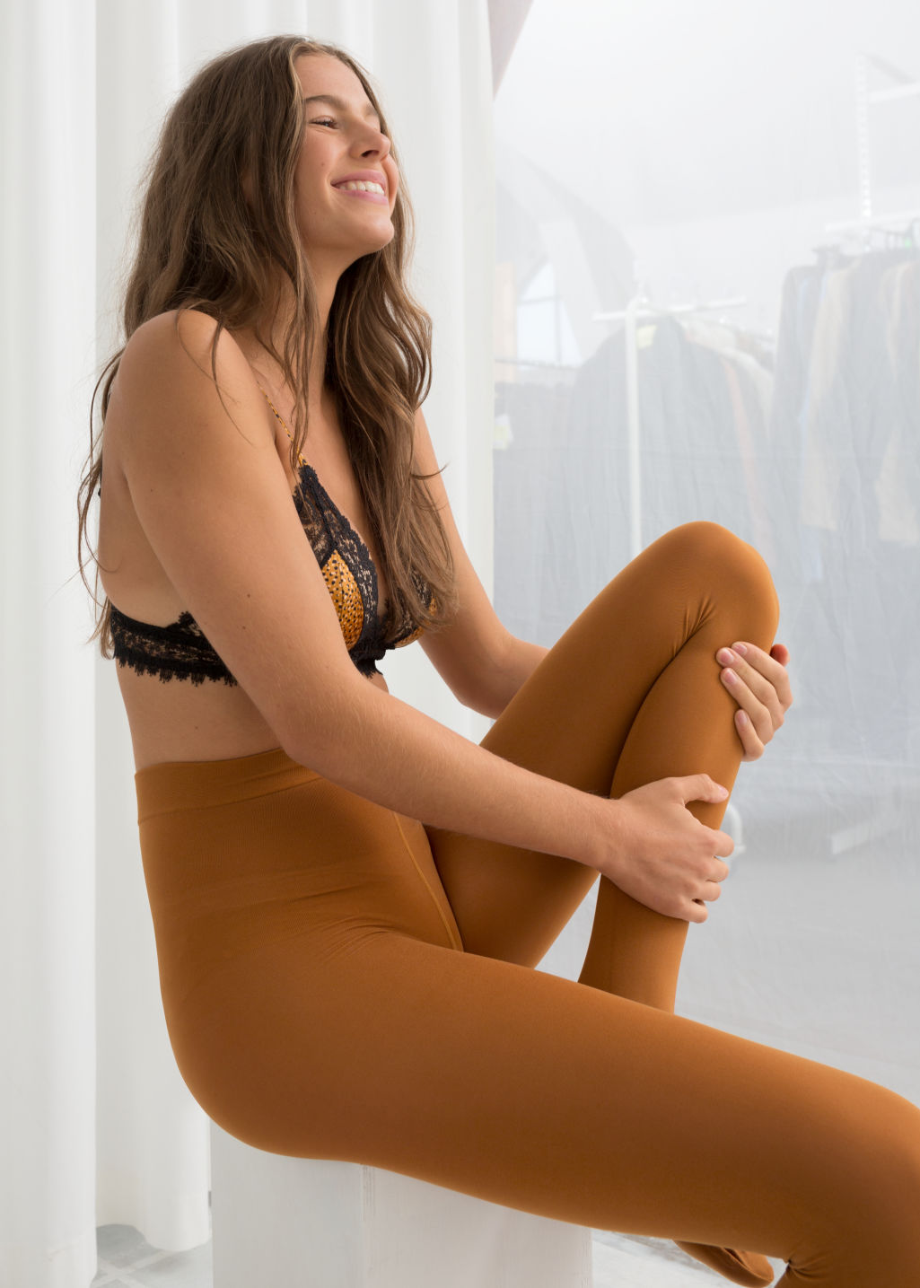 Front image of Stories 100 denier tights in orange
