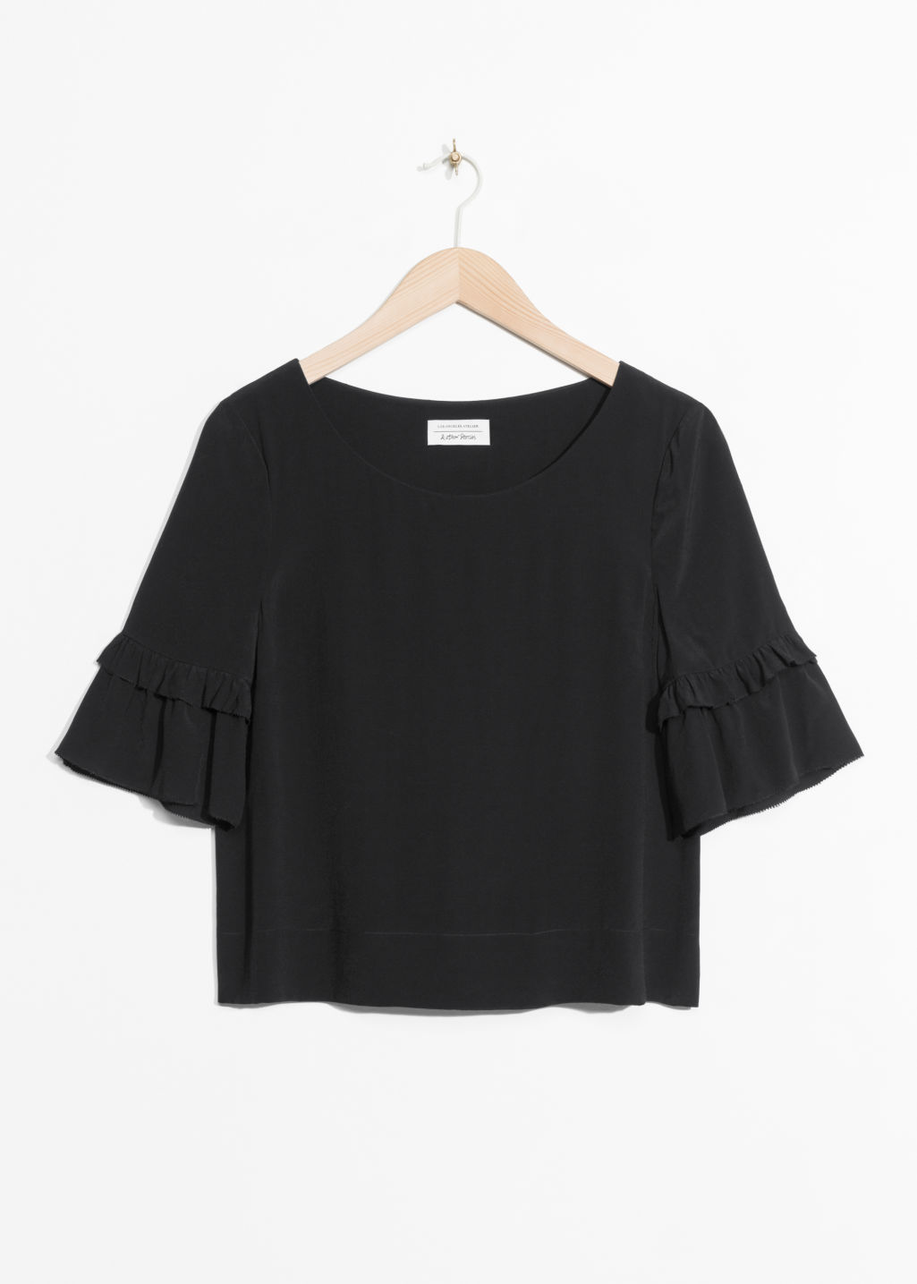 Front image of Stories ruffle sleeves blouse in black