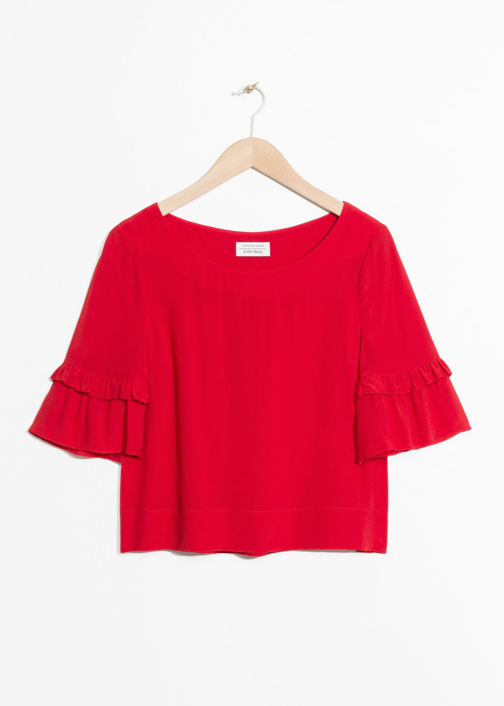 Front image of Stories ruffle sleeves blouse in red