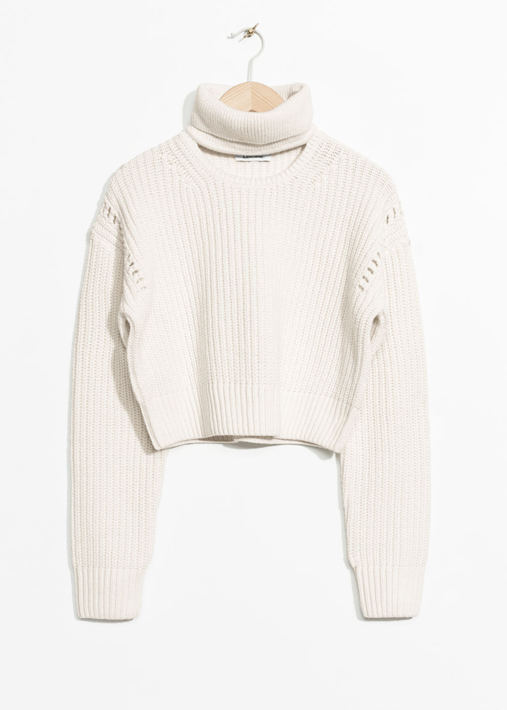 Front image of Stories crop turtleneck sweater in white