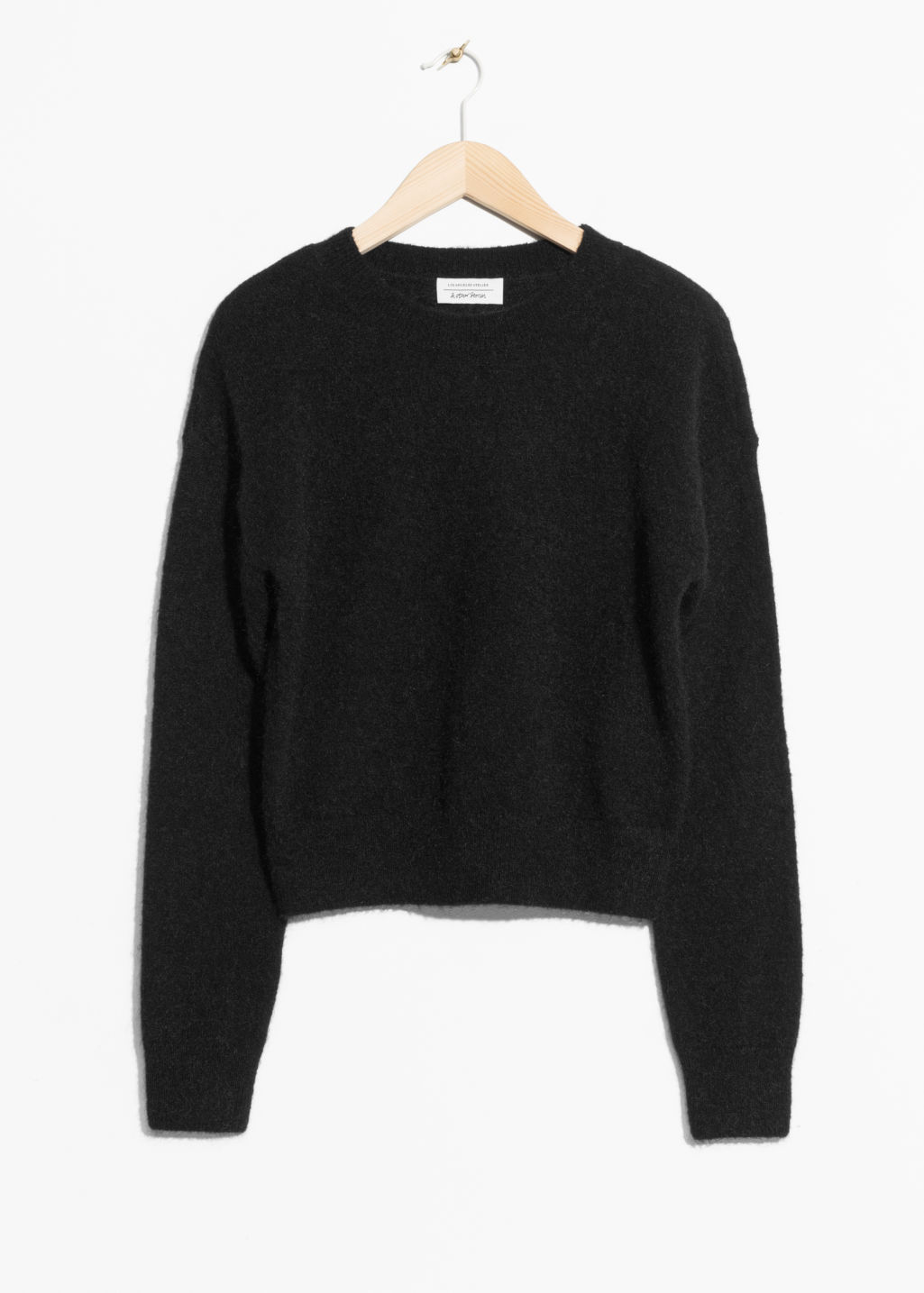 Front image of Stories mohair & wool sweater in black