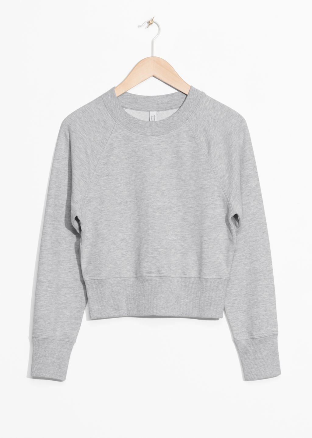 Front image of Stories raglan sleeve sweater in grey