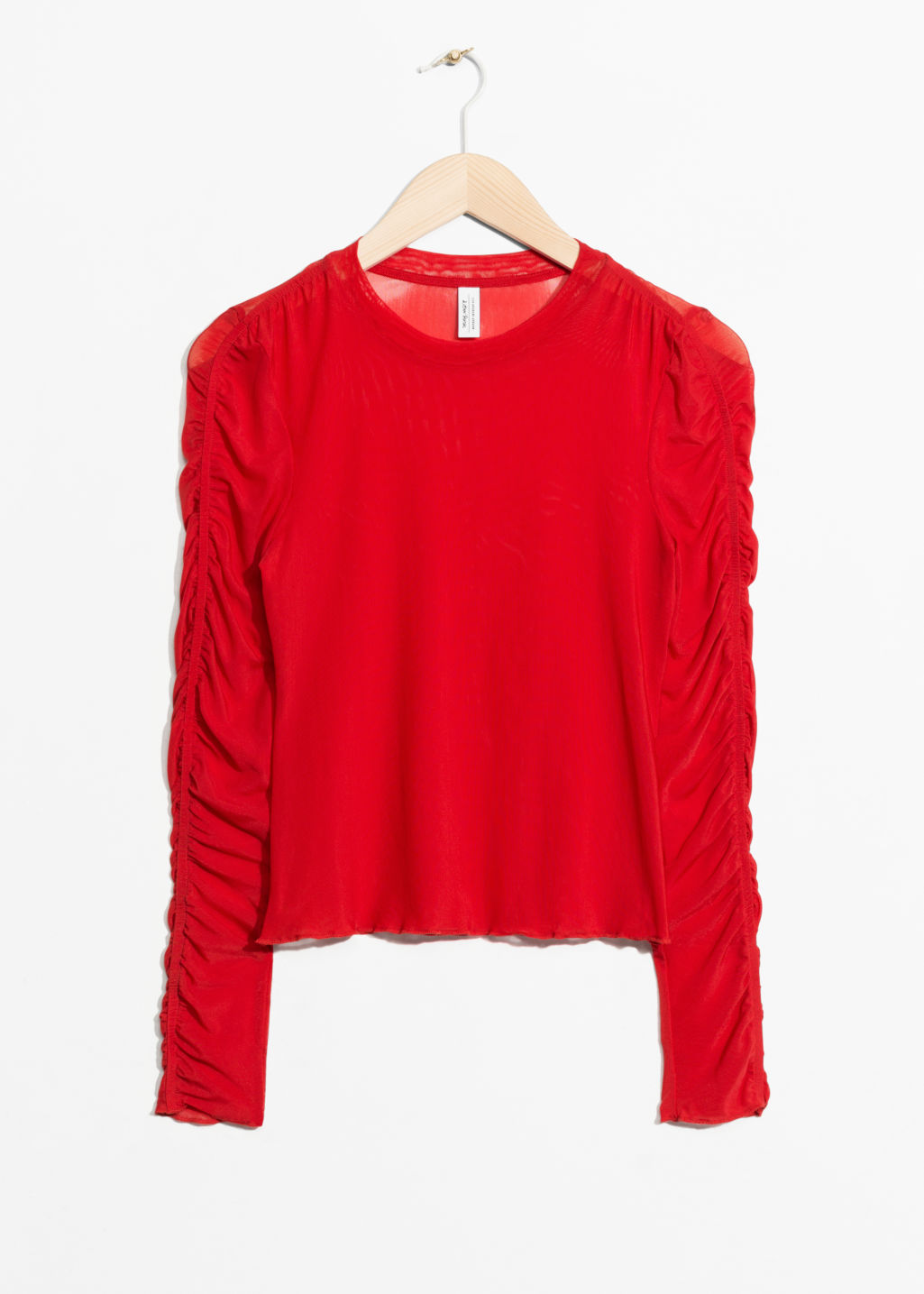 Front image of Stories gathered sleeve top in red