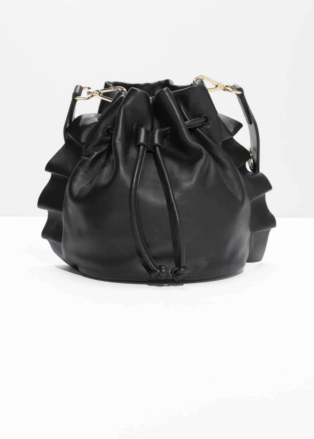 Front image of Stories frill leather bucket bag in black