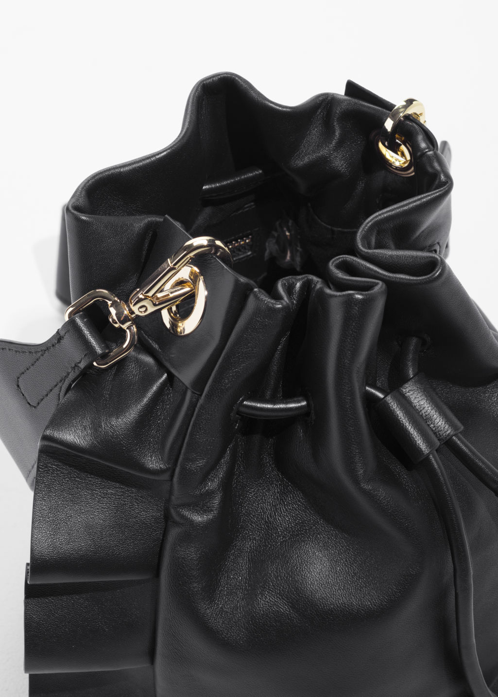 Back image of Stories frill leather bucket bag in black