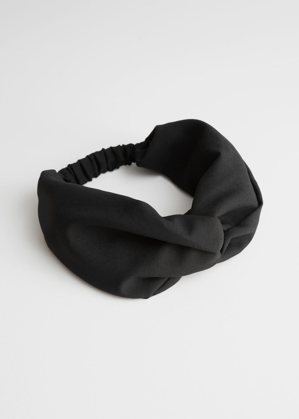 Front image of Stories voluminous headband in black