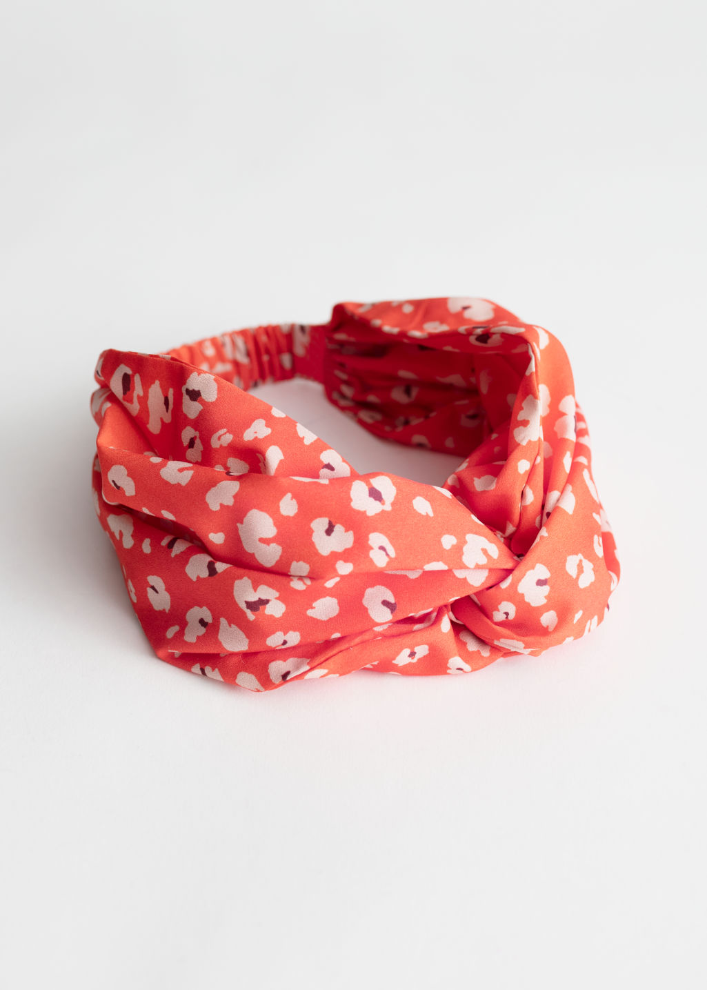 Front image of Stories voluminous hairband in orange