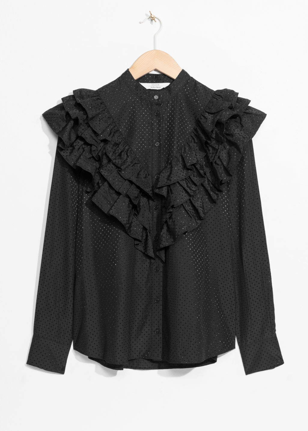 Front image of Stories ruffle blouse  in black