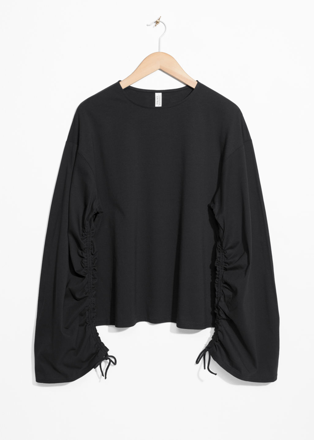 Front image of Stories drawstring sleeves top in black