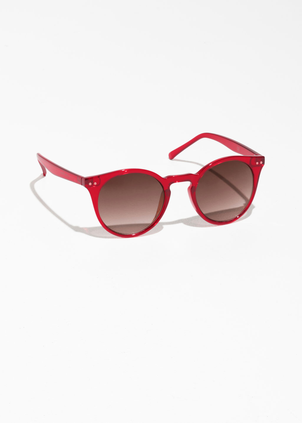 Front image of Stories rounded sunglasses in red