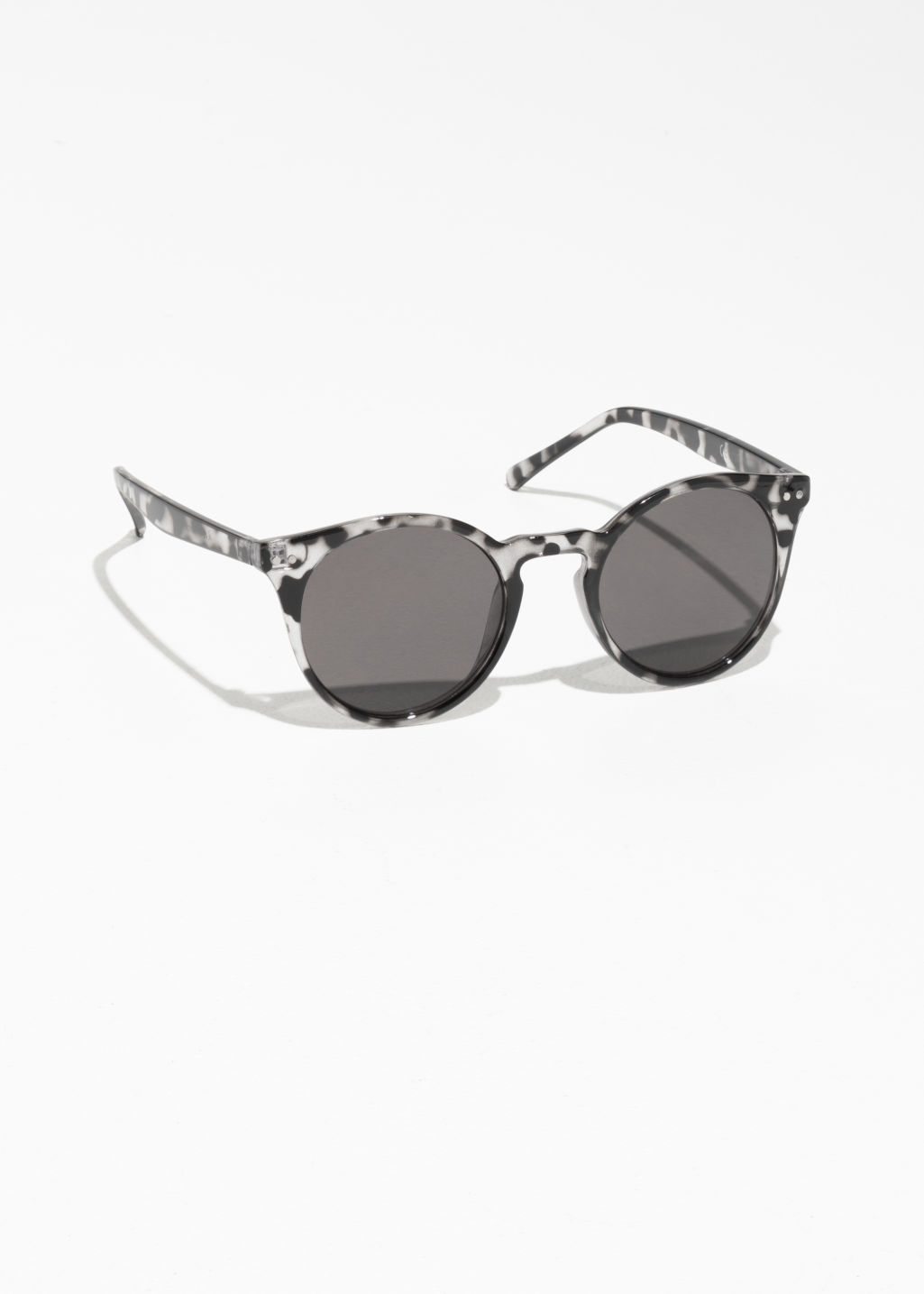 Front image of Stories rounded sunglasses in black