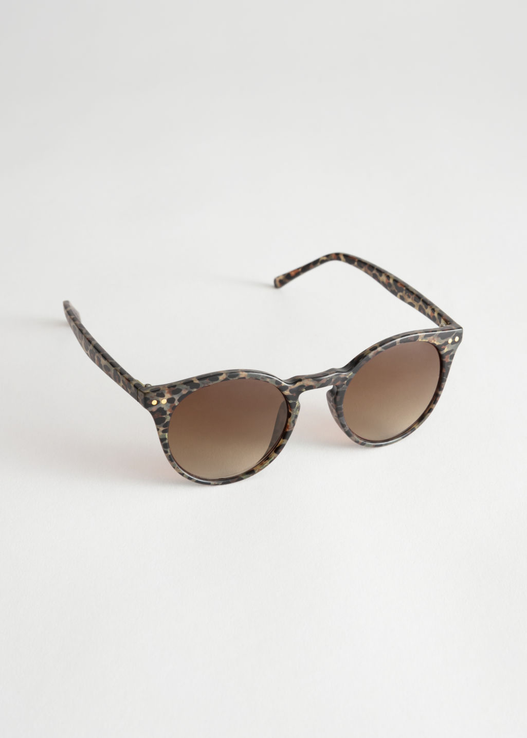 Front image of Stories rounded sunglasses in beige