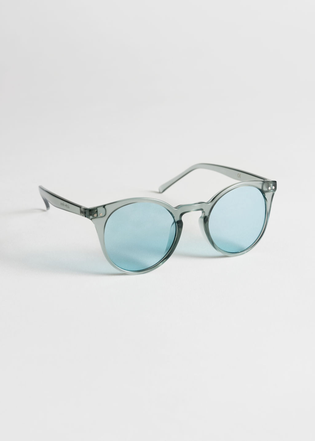 Front image of Stories rounded sunglasses in turquoise