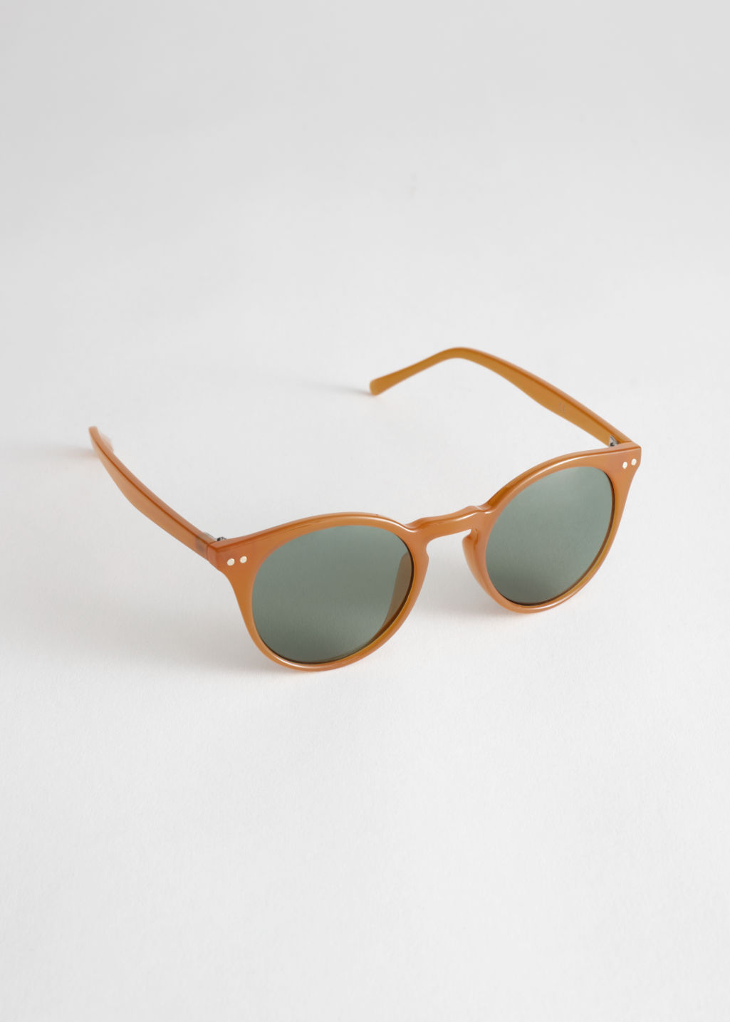 Front image of Stories rounded sunglasses in orange