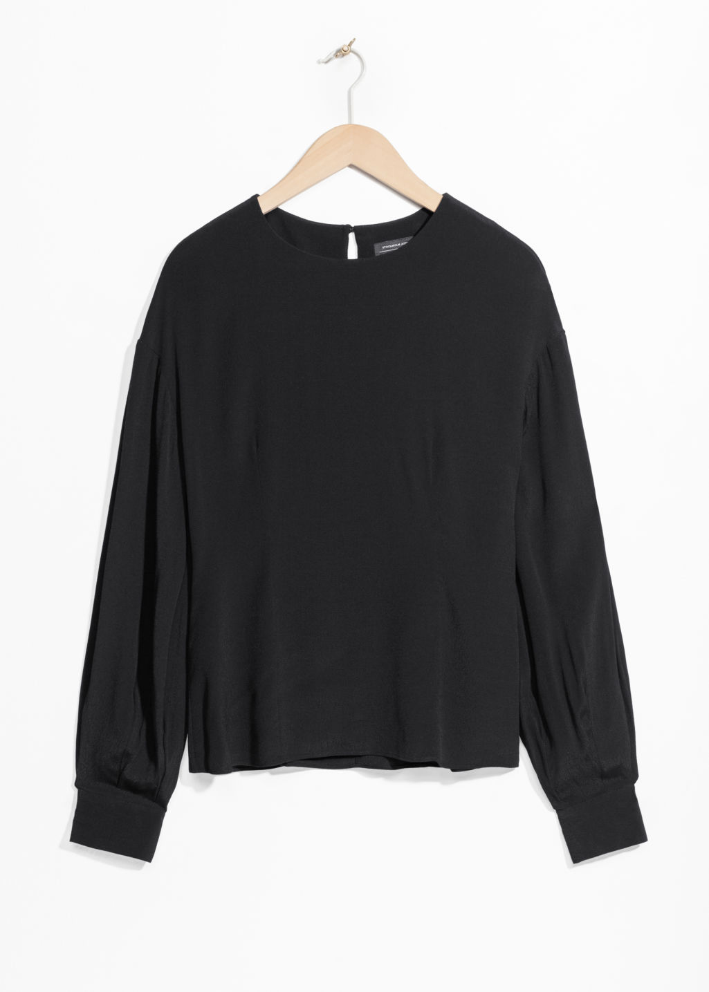 Front image of Stories oversized sleeve blouse in black