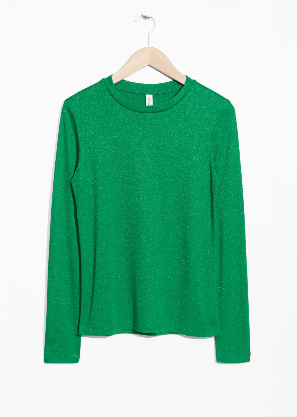 Front image of Stories lurex top in green