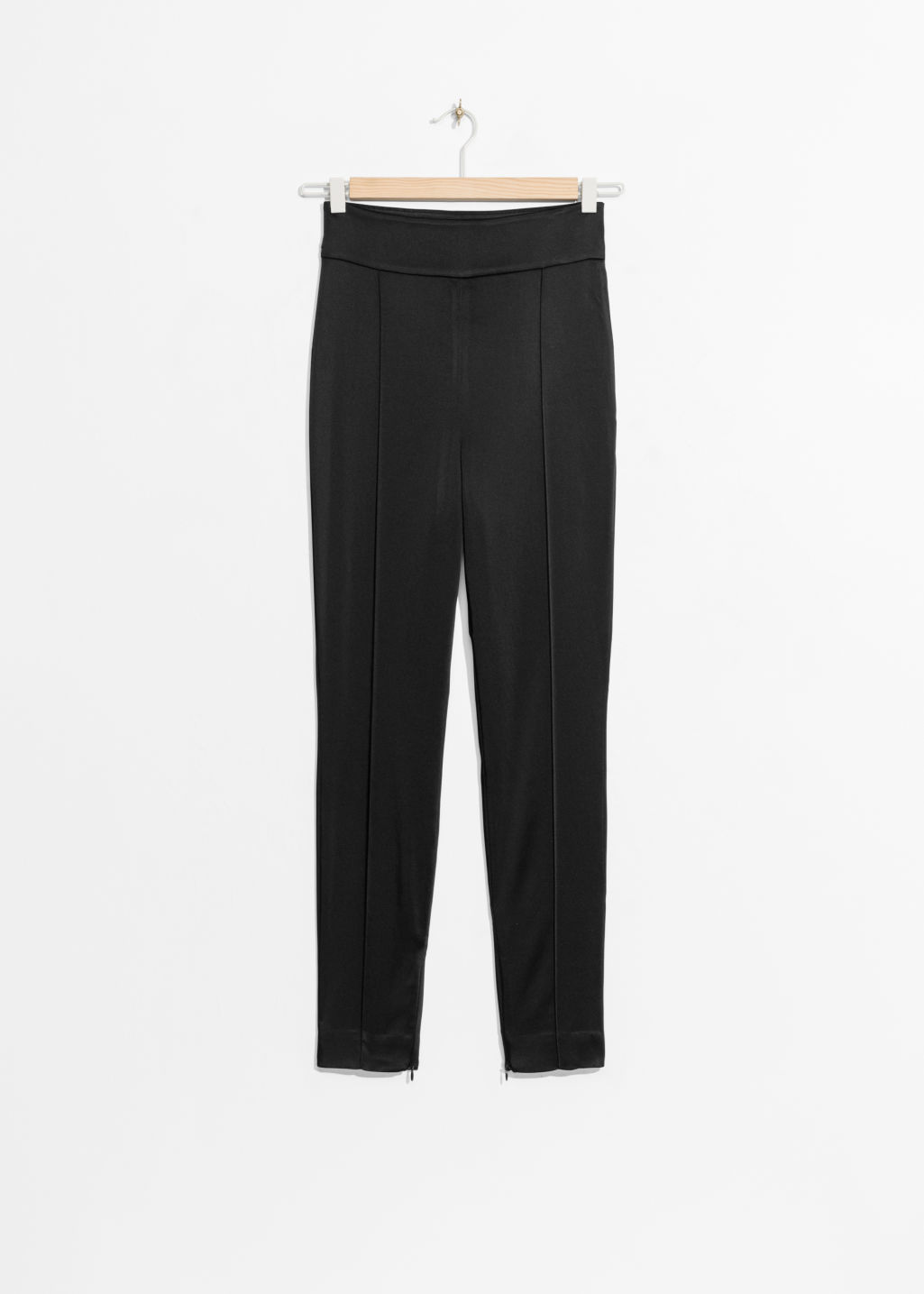 Front image of Stories high-rise trousers in black